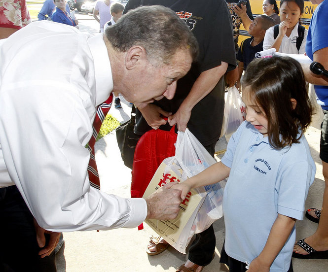 Superintendent Meza greets a young Jefferson Parish student.